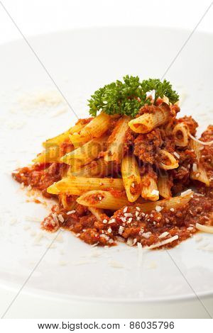 Pasta Penne with Bolognese Sauce. Garnished with Parsley