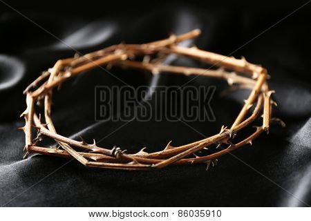 Crown of thorns on black cloth