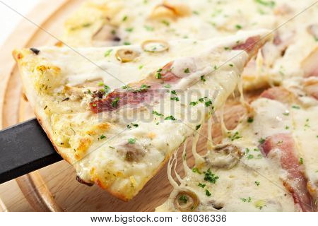 White Pizza made from Sour Cream Sauce, Mushrooms, Ham and Mozzarella Cheese