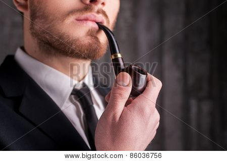 Smoking A Pipe.