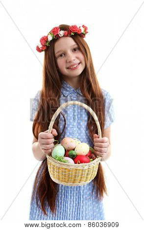 Beautiful little girl holding wicker basket with Easter eggs, isolated on white