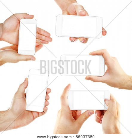 Hands holding smart phones isolated on white
