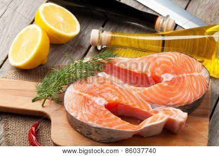 Salmon and spices on wooden table