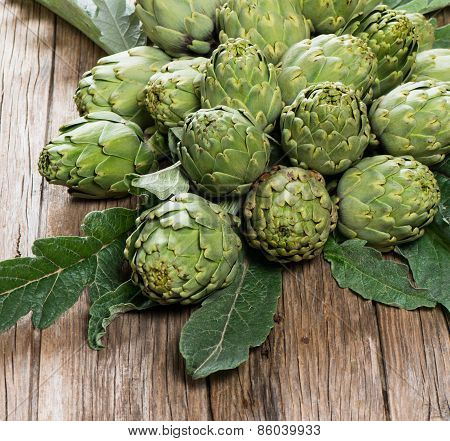 Artichokes On A Wooden