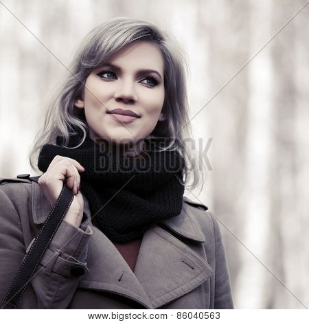 Happy young blond fashion woman walking outdoor