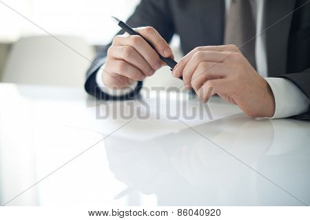 Man holding pen in his hands