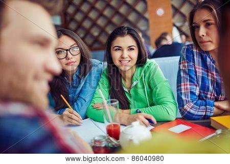 Three girls listening to their friends