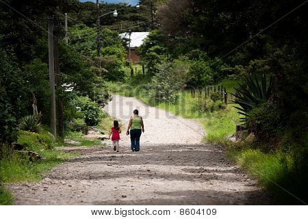 Woman And Child Walking In Costa Rica