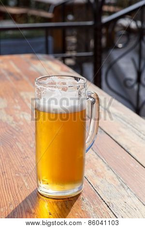 Beer Glass On A Little Table Of Cafe