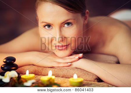 Woman relaxing at beauty spa looking at camera