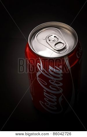SABAH, MALAYSIA - APRIL 6, 2015: Can of Coca-Cola on bar desk, close-up. Coca-Cola Company is the le