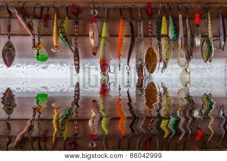 Reflection Different Fishing Hooks In The Water