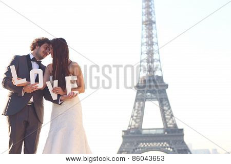 Bride And Groom Holding Love Letters In Their Hand In Paris, France