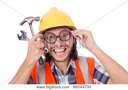 Funny construction worker with hammer and wrench isolated on white