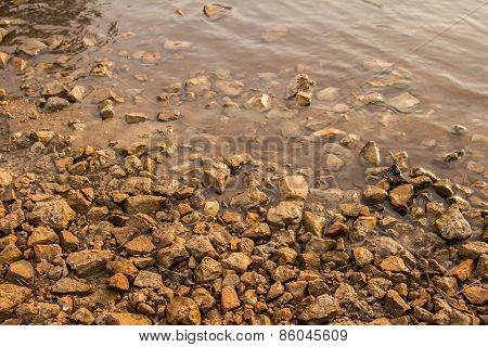 background texture of stones in a small Yushut river