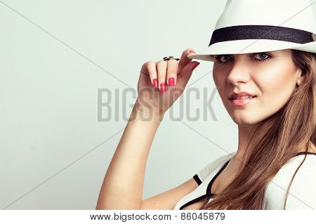 Fashion portrait of a beautiful young woman in a hat