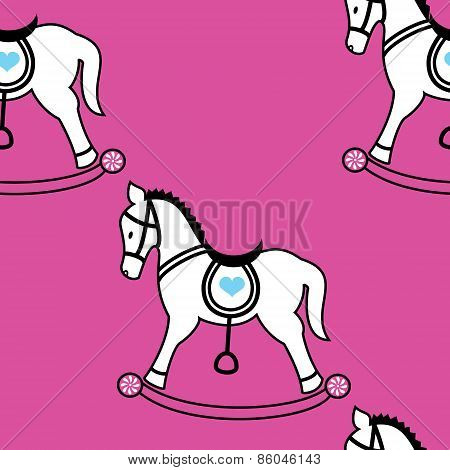 Rocking horse icons seamless wallpaper on pink background