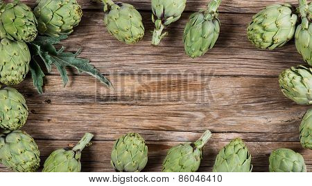Artichokes On Wood Background With Space For Text