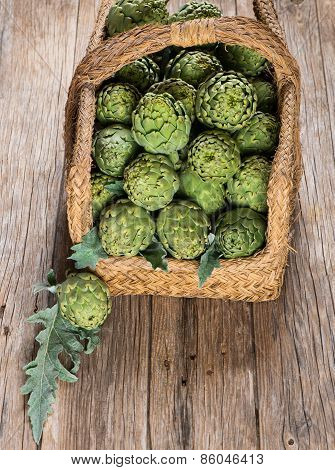 Artichokes With Leaves In Basket