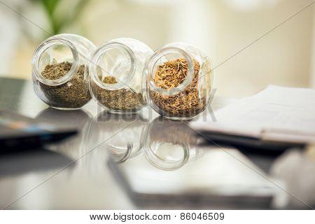 Herbal medicine - jars of herbs on the table. Homeopathy