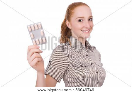 Young woman with pills isolated on white