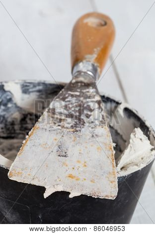 Spatula With Plaster And Mixing Tub