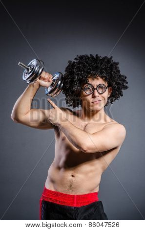 Guy trains with dumbells isolated on white