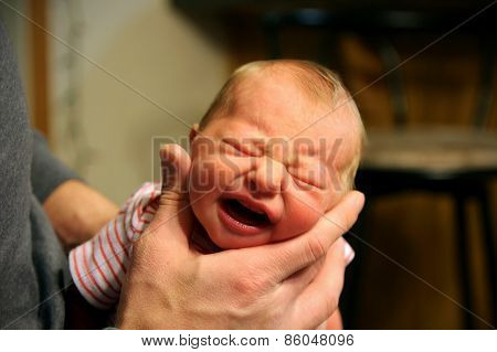 Crying Newborn Baby Being Burped By Father