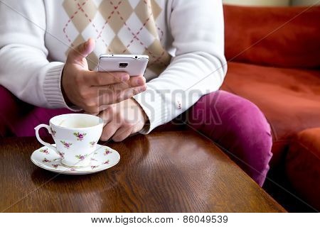 Man With Smartphone And Cup Of Coffee