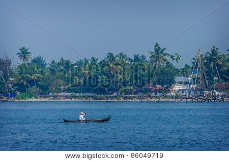 Indian fishermen at the city port Kochin, India.