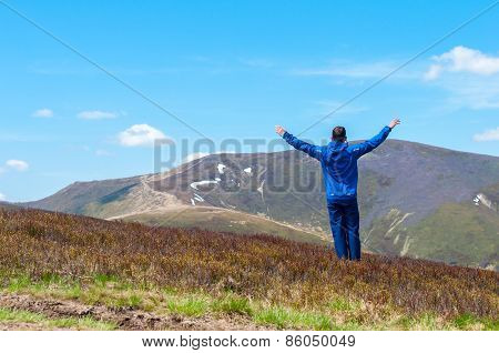 Tourist, man and success in mountains, arms raised. Running, sports, fitness healthy lifestyle outdo