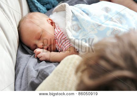 Newborn Baby Girl Sleeping In Father's Arms