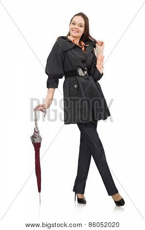 Cute girl in warm dark coat isolated on white