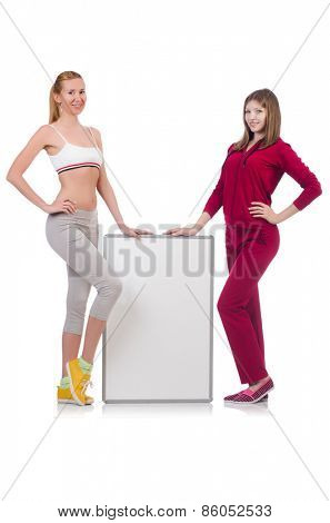 Girls in sport costumes isolated on white