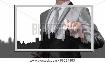 Businessman Drawing City Line, Business Concept