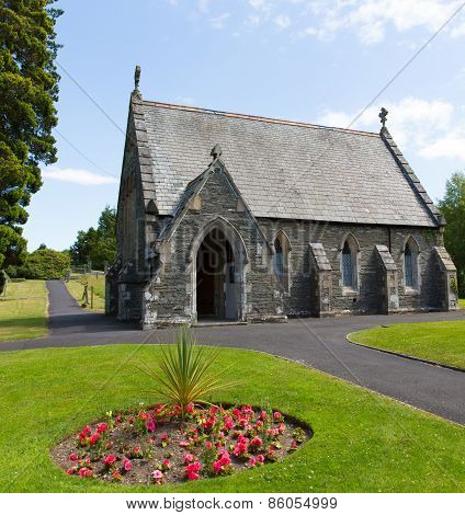 The cemetery church Bowness on Windermere Lake District Cumbria England UK in summer with flowers