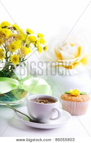 Breakfest With Tea, Cake And Yellow Flowers