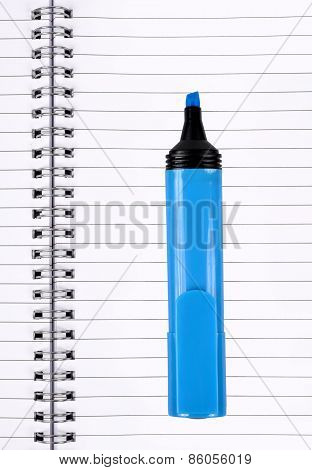 workbook with blue felt-tip