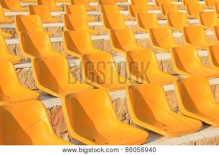 Stadium Yellow Chairs At Sun Light.