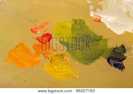 Oil paint on artist's palette. Suitable as background.
