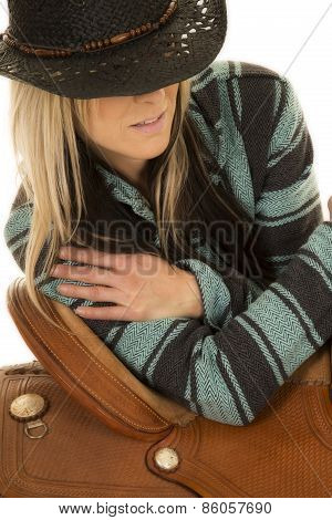 Cowgirl In Blue And Black Poncho Lean On Saddle Look Down To Side