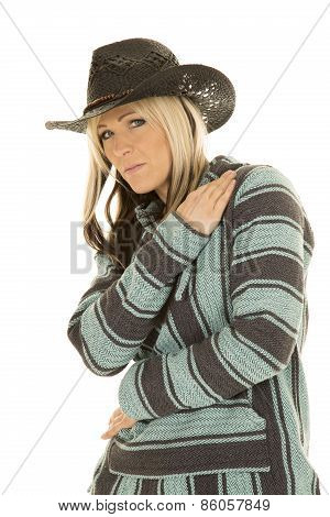 Cowgirl In Blue And Black Poncho Looking Arm On Shoulder