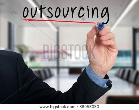 Businessman hand writing Outsourcing. Business concept.