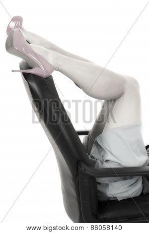 Woman Legs In Pink Heels Lay On Office Chair Knees Bent