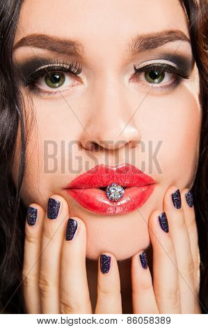 Portrait Of Fashionable Woman Holding A Jewel In Lips
