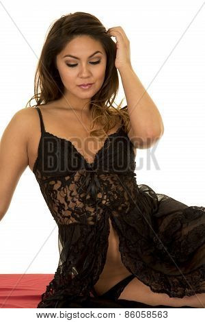 Woman In Black Lingerie Sittin On Red Sheet Looking Down