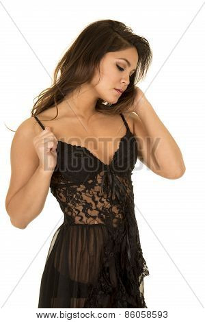 Woman In Black Nightgown Look Down To Side