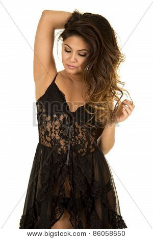 Woman In Black Nightgown Playing With Hair