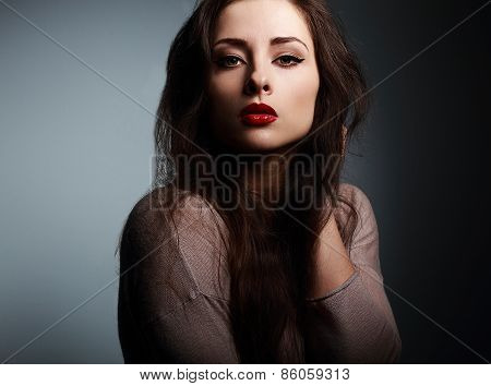 Sexy Makeup Woman With Red Lipstick Looking On Dark Shadows Background