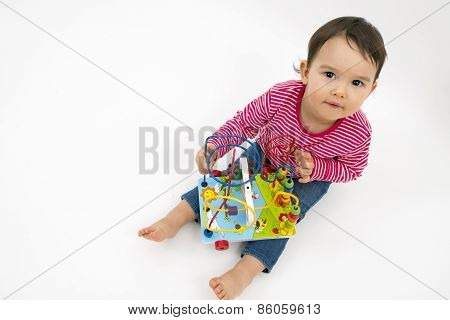 little girl happy with colorful wooden Toys isolated on white background